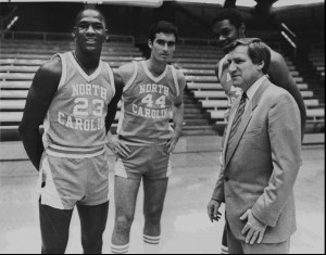 An Associated Press image Dean Smith (right) with then-freshman Michael Jordan (left) and two other members of the 1982 UNC basketball team.