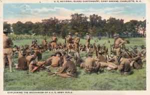 Image from the N.C. Museum of History A 1947 postcard depicting soldiers learning how to use rifles at Camp Greene.