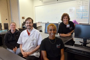 An RCC photo Pictured seated from left are RCC Health Information Technology students Brittany Herndon, Grant Colden and Ryanne McEachin. In back is RCC Health Information Technology Program Director Susan Long.