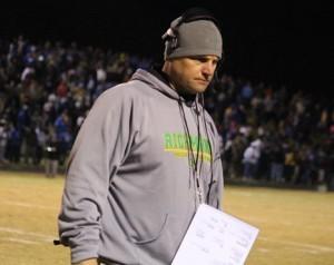 Kevin Spradlin | PeeDeePost.com Raiders football coach Paul Hoggard prowls the sidelines during the 2014 season.