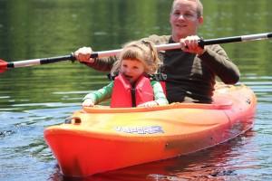 Stephanie Spradlin | PeeDeePost.com Ivey Lynn Medlin, 3, looks on as the shoreline becomes smaller and smaller at the start of her kayak adventure.