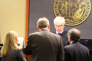 Kevin Spradlin | PeeDeePost.com Superior Court Judge Richard T. Brown, Assistant District Attorney Dawn Layton and defense attorneys Frank Wells (center) and Stephen Freedman confer at the bench.