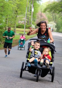 Kevin Spradlin | PeeDeePost.com Kimberley Lingler, a local family physician, pushes her sons ages 3 and 2, up Love Lane in Mile 2 on Saturday of the Run for the Ribbons 5K in Rockingham.