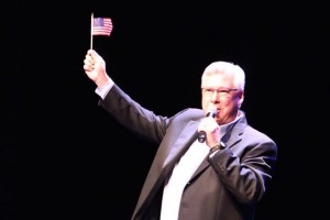 "Kevin Spradlin | PeeDeePost.com James Bailey ends his version of ""God Bless the U.S.A."" with a wave of the American flag."