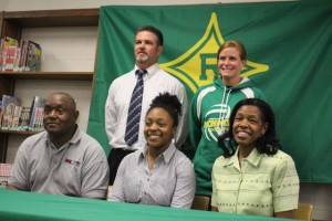Kevin Spradlin | PeeDeePost.com Davina LeGrande, seated in center, is situated between her parents, Donnie and Pamela LeGrande. Standing behind them is Athletic Director Ricky Young and head volleyball coach Shellie Wimpey.