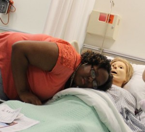 Kevin Spradlin | PeeDeePost.com Khyana Bennett, 19, of Laurinburg, is an aspiring nurse and checks out a mannequin that can deliver a baby - simulated, of course. The simulator is one of many high-dollar investments made by RCC's nursing faculty.
