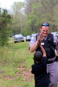 Kevin Spradlin | PeeDeePost.com A Hamlet Police Department officer connects with a young man who recently visited police HQ during a school trip.