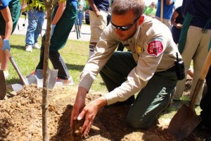 "Kevin Spradlin | PeeDeePost.com Chris McGee, assistant county ranger with the North Carolina Forest Service, and County Ranger Matt Gordon led students in planting two Kousa Dogwood trees in honor of Dr. William ""Bill"" Williams."