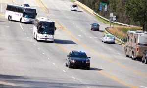 Kevin Spradlin | PeeDeePost.com Richmond County Sheriff's Office deputies escort two charter buses carrying the Rockingham Middle School Choir off Interstate 74 onto U.S. Route 1 near Waffle House Sunday morning in Rockingham.
