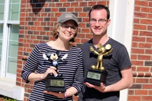 Kevin Spradlin | PeeDeePost.com Lauren Lutz, RMS choral director, and John Tyson display the first-place trophies earned by the Rockets choir on Friday at Walt Disney World in Orlando.