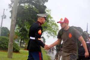 Kevin Spradlin | PeeDeePost.com Marine Sgt. Michal Martinez left his Rockingham recruiting station office to greet the military veterans marching to raise awareness of suicides among military veterans. It's an epidemic, they said.