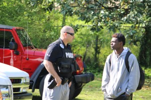 Kevin Spradlin | PeeDeePost.com Delvin Davis, 19, of Hamlet, is expected to be charged with contributing to the delinquency of a minor after making plans to meet a 15-year-old Rockingham girl whom he'd met online in a vacant home on Monday on Rockingham Road. In the photo, Davis is talking with Sgt. Glen Harris with the Rockingham Police Department.