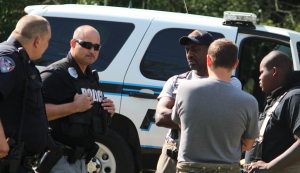 Kevin Spradlin | PeeDeePost.com Personnel with the Rockingham Police and Rockingham Fire departments discuss the situation of an 18-year-old man and 15-year-old girl who met online and used a vacant home to meet in person.