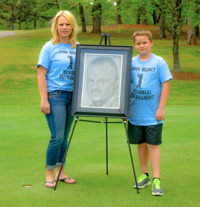Submitted photo Sandy Searcy and her son, Zane, stand with an image of the late John Searcy drawn by Marston-area artist Brandon Parrish.