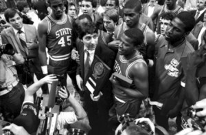 Image from the State Archives and copyright the News & Observer. Coach Jim Valvano and members of the N.C. State men's basketball team celebrate after their 1983 championship win.