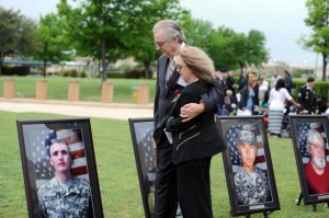 Jeffrey and Sheryll Pearson pause to look at the portrait of their son, Pfc. Michael Pearson, before the start of the Fort Hood Purple Heart and Defense of Freedom Medal Ceremony Friday at III Corps Headquarters in Fort Hood, Texas.