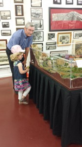 Photo by Laurel Packer E.J. Carver, 5, listens as National Railroad Museum and  Hall of Fame board member Bill Wallace talks about the model railroad display.