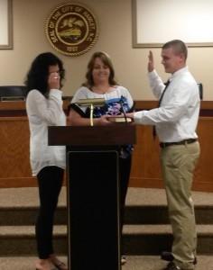Submitted photo Officer Skyler Dover is sworn in by Hamlet City Clerk Tammy Kirkley.