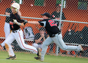 Kevin Spradlin | PeeDeePost.com Hamlet third baseman Dawson Bryant tags out the Rockets' Garrett Weigman for the second out in the bottom of the third inning.
