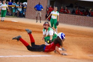 Kevin Spradlin | PeeDeePost.com Hailey Clark pulls off the front part of a double steal at third in the top of the fourth inning as Doodle Jacobs applies a late tag.