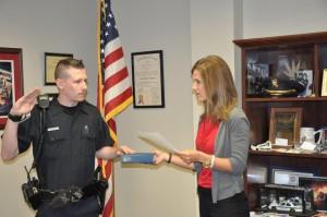 Submitted photo Village of Pinehurst Clerk Lauren Craig swears in Officer Cameron Parent.