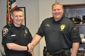 Submitted photo Officer Cameron Parent is welcomed by Police Chief Earl L. Phipps.