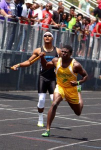 Kevin Spradlin | PeeDeePost.com Dante Miller ran out of room in the boys 800-meter relay on Saturday at Pinecrest High School.