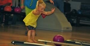 Kevin Spradlin | PeeDeePost.com Jasey Braddock, 3, of Rockingham, let's the bowling ball fly – er, crawl – down the lane last June at Striker's Bowling Center.