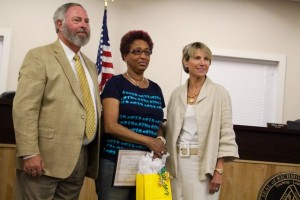 Kevin Spradlin | PeeDeePost.com Melissa Watkins, center, with Board of Education Chairman Wiley Mabe and Superintendent Dr. Cindy Goodman.