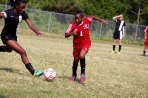 Kevin Spradlin | PeeDeePost.com Jayana Nicholson, right, notched an assist in the Red Rams' 4-0 victory over Rockingham on Friday in the conference championship.