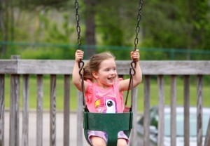 Kevin Spradlin | PeeDeePost.com Chloee Macedo, 3, of Hamlet, enjoys time on the swing at Castlewood Park.