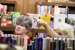 Kevin Spradlin | PeeDeePost.com Ann Moore shows off several pieces to a Kemp-Suggs Memorial Library visitor and former senior center volunteer instructor.