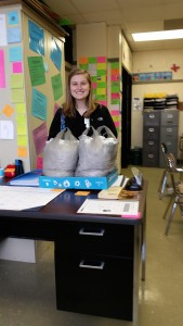 Submitted photo Molly Russell, president of the RSHS Beta Club, is shown with 23 pounds of poptabs collected by RSHS students.