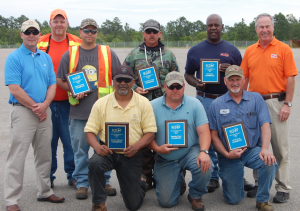 "Submitted photo Front Row: Hereld Dowdy(Tractor Mower- Roadside Environmental) Steven Perkins(Tandem Truck- Scotland Maintenance), Allen Hancock(Single Wheel Base     Dump Truck -Richmond Equipment). Back Row: Rob Stone(Division Engineer), Jay Lewis(Division Safety Officer),John Bean(Motorgrader-Montgomery Maintenance), James ""Viper""Peters(Lowboy Truck-Montgomery Maintenance),James Hines(Backhoe -Moore Maintenance), Danny Oldham (Division Safety Consultant)."