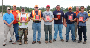 "Submitted photo Rob Stone(Division Engineer), Jay Lewis(Division Safety Officer), James Morris(Motorgrader-Montgomery Maintenance), Fred Harrelson(Lowboy Truck-Randolph Maintenance), Travis Warren(Tandem Dump Truck-Randolph Bridge), Brad Cook(Backhoe-Lee Maintenance), James ""Buck"" Dawkins(Tractor Mower-Richmond Maintenance), Danny Oldham(Division Safety Consultant), Charles Ford (Single Wheel Base Dump Truck-Richmond Equipment."