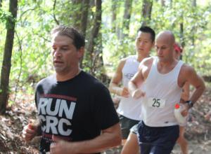 MacKenzie Spradlin   PeeDeePost.com Joe Fejes (25) circles Hinson Lake, but called it quits early in the 2014 race. The 2013 Hinson Lake winner just ran into the ultra running history books.