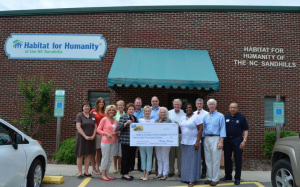 A Habitat for Humanity of the NC Sandhills photo  Front (left to right): Jana Green, Linda Lindsey, Rita DiNapoli, Alice Robbins, Marilyn Morgan Grube, Lesley King (Perdue), Wayne Osborne, Paul Davis   Back (left to right): Amie Fraley, Carolyn Giltzow, Tim Dwyer, Rev. Michael Dubbs, Michael LaGraff, Jeff Casey