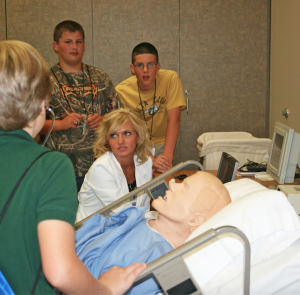 Submitted photo  NETC Nursing instructor Holly Copeland shows Camp Exploration campers how robotics are used to train nursing students.