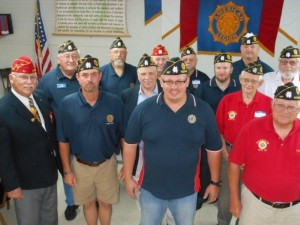Submitted photo Southeast Region Legion National Vice Commander Richard Neville, first row left, Friday night installs new officers of Rockingham American Legion Post 147. Officers are, left to right, first row, Wayne Johnson, John Carr and Carlton Hawkins; second row, Phil Bradley, Michael White and David Williams; third row, Thomas Schoonover, Jeff Joyner, James Gross and Arthur Beardsley; fourth row, Richard Lunceford and Robert Steele.