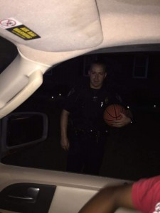 "Submitted photo Monday night was the second time Spring Lake Police Officer Brandyn Lyles was ""caught"" playing basketball with area residents."