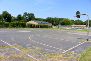 Kevin Spradlin | PeeDeePost.com With the new Community Center in the background, the dilapidated basketball court at the Dobbins Heights Community Park is expected to be repaired soon.
