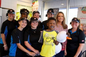 Kevin Spradlin | PeeDeePost.com Kwalei Reynolds, 4, poses with Jeanna Cloninger, Dairy Queen store manager (right), and the rest of the evening crew Wednesday in Rockingham.