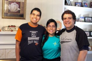"Kevin Spradlin | PeeDeePost.com Jonathan Hernandez stands with his parents, Diana Janica and Pablo Hernandez, in their Rockingham home, dubbed ""Faith House."""