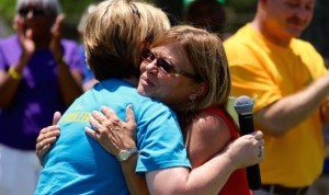 Kevin Spradlin | PeeDeePost.com L.J. Bell Elementary School Principal Yvonne Gilmer, left, embraces Julie Curry, a new Richmond County Schools retiree.