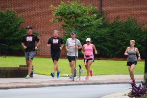 Kevin Spradlin | PeeDeePost.com From left to right: Jerry Lindstrand, Clea Smith, Mark Long, Rosemary Baxley and Chris Kubiak run against traffic along East Washington Street en route to Eastside Cemetery and Hinson Lake.