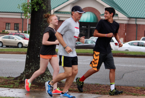 "Kevin Spradlin | PeeDeePost.com Evans ""Bones"" Baxley, right, and Alix Giddens, left, keep pace with Mark Long during the start of a planned six-mile run in recognition of National Running Day."