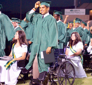 Photo by Jerry Ethridge Jonathan Hernandez was able to attend the 42nd annual commencement ceremony Friday night at Richmond Senior High School. Here he stands with his 441 fellow graduates and turns his tassle from left to right.