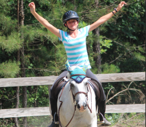 Kevin Spradlin | PeeDeePost.com Madison Evans, from Union County, shows her happiness before the start of the jumps.