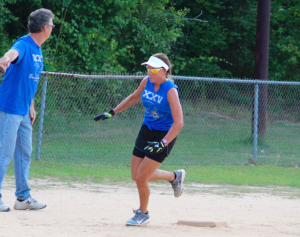 Kevin Spradlin | PeeDeePost.com Coach Frank Stooksbury waves Robin Kapp home. App rounded third scored the senior team's fourth and final run in a 16-4 loss.