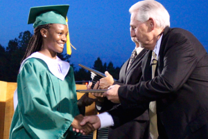 Kevin Spradlin | PeeDeePost.com Javae Cross accepts her diploma from Richmond Senior High School Principal Keith  McKenzie during the Raiders' 42nd annual commencement Friday night in Rockingham.
